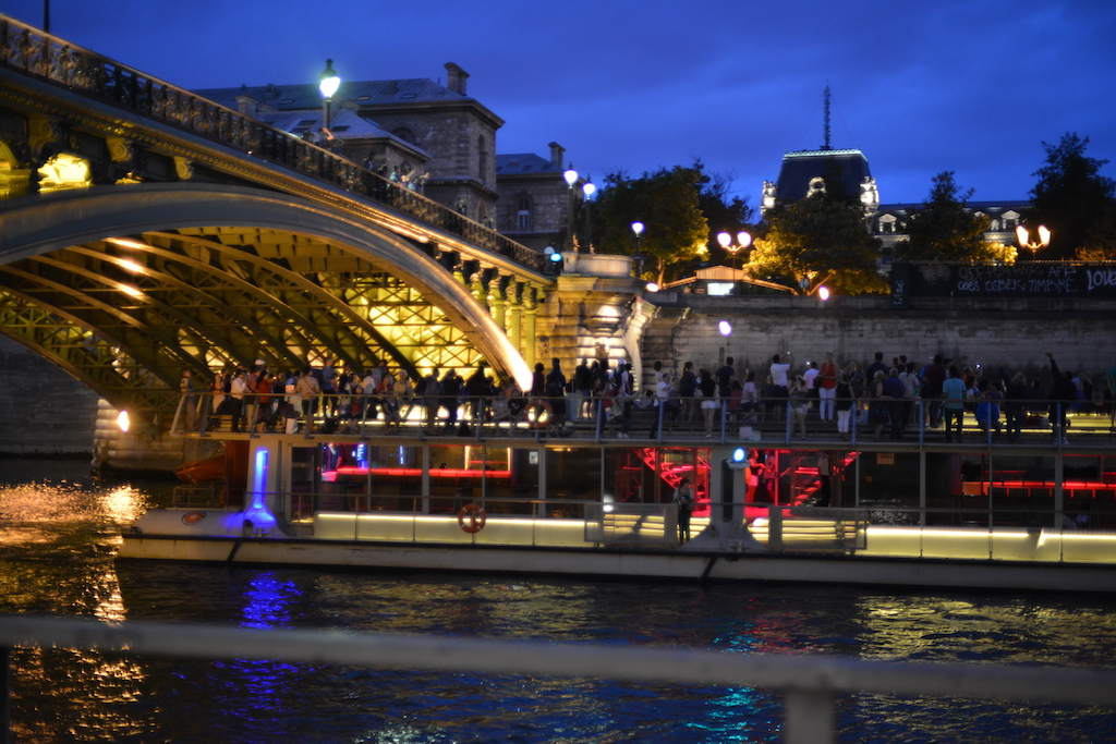 Paris Plages- A river cruise boat under the Pont Notre Dame