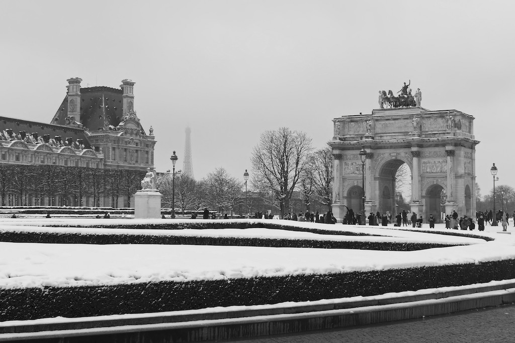 The Louvre under the snow with the Eiffel Tower in the background - Paris - February 2018